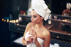 Free Woman With Towel Holding Glass Of Champagne Royalty Free Stock Image - 63210096