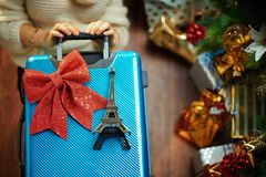 Woman With Travel Suitcase And Eiffel Tower Souvenir Stock Image