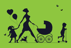 Woman With Two Children And Dogs. Super Mother Walks Royalty Free Stock Photos