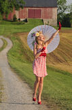Woman With Umbrella Waving Royalty Free Stock Images