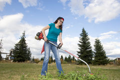 Woman With Weedwacker Royalty Free Stock Image