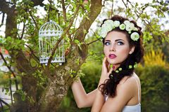 Woman With White Flowers In Hair And Birdcage Stock Image