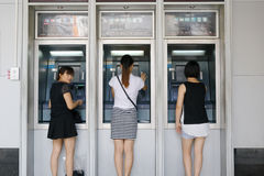 Woman withdraw at the atm of chine industrial and commercial bank Royalty Free Stock Photo