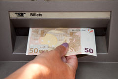 Woman withdraw money at cashpoints. ATM Access : a womans hand withdraws money at cashpoints Stock Photos