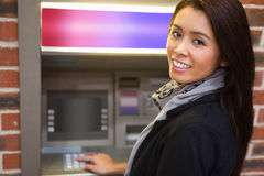 Woman withdrawing cash Royalty Free Stock Images