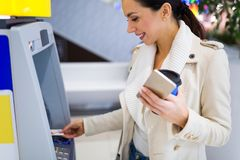 Woman withdrawing cash at an ATM Stock Photos
