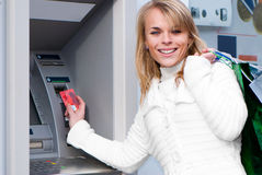 Woman withdrawing money Stock Image