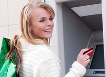 Woman withdrawing money Royalty Free Stock Photography