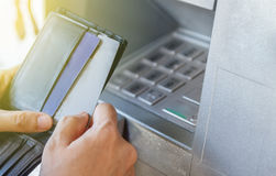 A woman is withdrawing money from an ATM,Cash withdrawal. Woman' Stock Photography