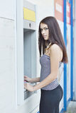 Woman withdrawing money from ATM machine Royalty Free Stock Photo