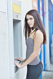 Woman withdrawing money from ATM machine Stock Image
