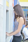 Woman withdrawing money from ATM machine Royalty Free Stock Photos