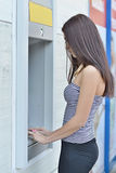 Woman withdrawing money from ATM machine Royalty Free Stock Photography