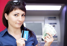 Woman withdrawing money from credit card at ATM Stock Images