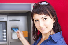 Woman withdrawing money from credit card at ATM Royalty Free Stock Photos