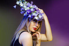 Woman withwith flower wreath. Professional Makeup and hairstyle Stock Photo