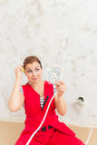 Woman wondering electric wiring Royalty Free Stock Photo