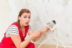 Woman wondering electric wiring Stock Photos