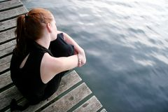 Woman wondering at lake Stock Photo