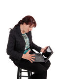 Woman wondering what is on laptop. Stock Photos