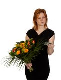 Woman is wondering who sent her flowers? Royalty Free Stock Images