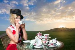 Woman at wonderland tea-party Stock Image