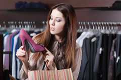 Woman wonders at excellent shoes. Pretty woman wonders at excellent fuchsia shoes Stock Image