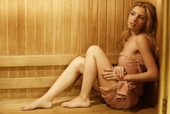 Woman in wood finnish sauna Stock Image