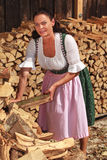 Woman in wood piles Royalty Free Stock Images