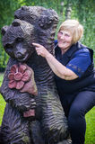 Woman and wooden bear Royalty Free Stock Image