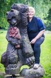 Woman and wooden bear Stock Photos