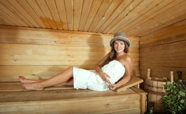 Woman  on wooden bench in sauna Royalty Free Stock Photography