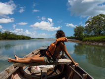 Woman on wooden boat Stock Photo