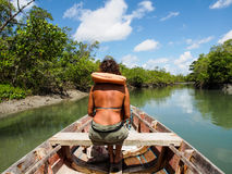 Woman on wooden boat Royalty Free Stock Images