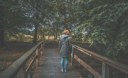 Woman on wooden bridge Stock Photo