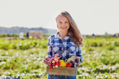 Woman with wooden crate of vegetables Royalty Free Stock Photography