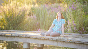 Woman on a Wooden Dock at Sunset Royalty Free Stock Images