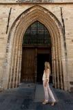 Woman wooden door Gothic Church stock photo