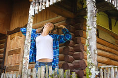 Woman in the wooden house, relaxed summery atmosphere Stock Images