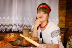 Woman with wooden rolling pin bakes bread Royalty Free Stock Image