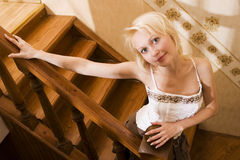 Woman on wooden stair royalty free stock photography