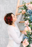 Woman at the wooden staircase and flower garland Royalty Free Stock Photography