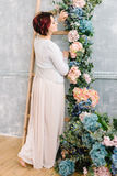 Woman at the wooden staircase and flower garland Stock Image