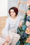 Woman at the wooden staircase and flower garland Stock Images
