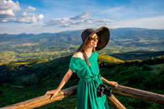 Woman on wooden terrace in the mountains Royalty Free Stock Photos