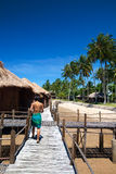 Woman on wooden walkway in a beautiful resort Stock Images