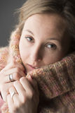 Woman with wool scarf Stock Photos
