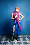 Woman in wool scarfs. Young woman in wool scarfs, studio shot, full body shot Royalty Free Stock Photo