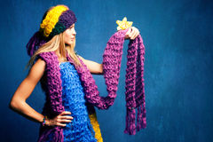Woman in wool scarfs Stock Photos