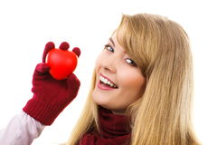 Woman in woolen gloves holding red heart, symbol of love Royalty Free Stock Photo